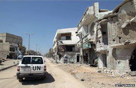 A UN vehicle drives through Homs in 2012
