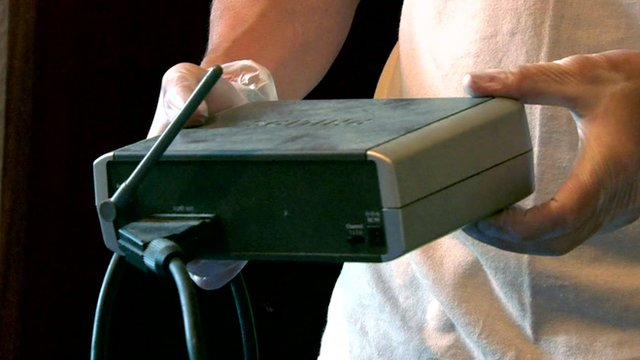 Police examine a router