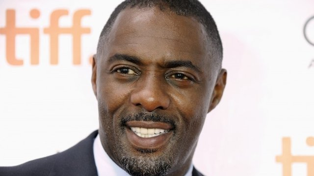 "Cast member Idris Elba poses on the red carpet before a screening of the film ""Mandela: Long Walk to Freedom"""