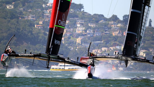 Team New Zealand (l) and Oracle Team USA contest America's Cup