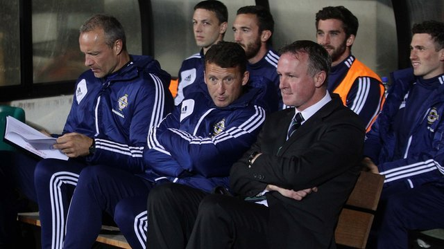 Michael O'Neill watches the match in Luxembourg