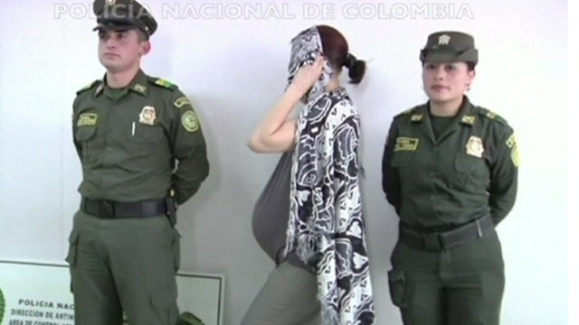 Canadian woman and two guards