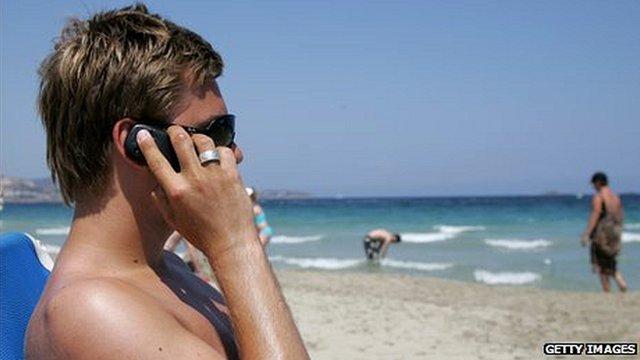 sunbather on phone