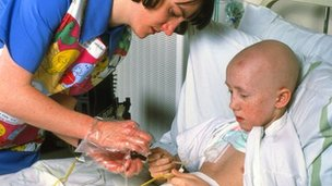 Child with leukaemia receiving hospital treatment