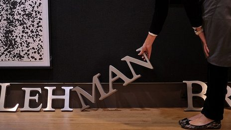 A Lehman Brothers sign is auctioned at Christies in London in 2010