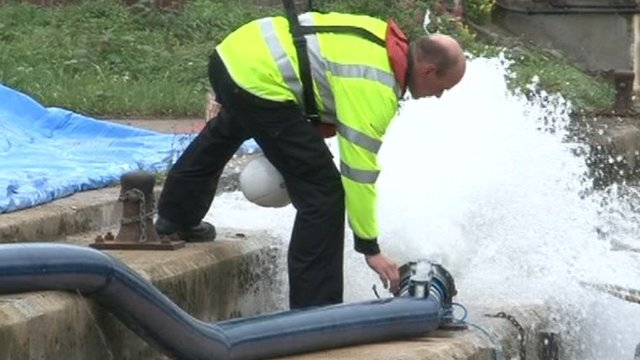 Environment Agency officer tests defences