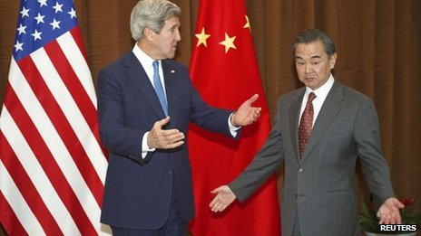 U.S. Secretary of State John Kerry gestures next to China's Foreign Minister Wang Yi (R) at the Chinese Ministry of Foreign Affairs in Beijing April 13