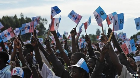 Supporters of the Rwandan President and the ruling Rwandan Patriotic Front (RPF) party attend a campaign rally in the capital Kigali on September 14, 2013,