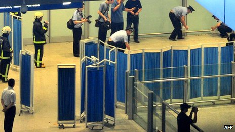 File photo: Chinese security personnel investigate the scene of the blast at Beijing's international airport terminal 3 on 20 July 2013