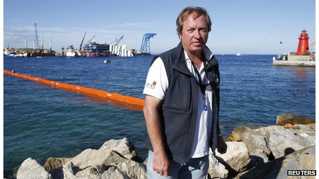 The head of the parbuckling project Nick Sloane poses as Costa Concordia lies on its side next to Giglio Island (14 September 2013)
