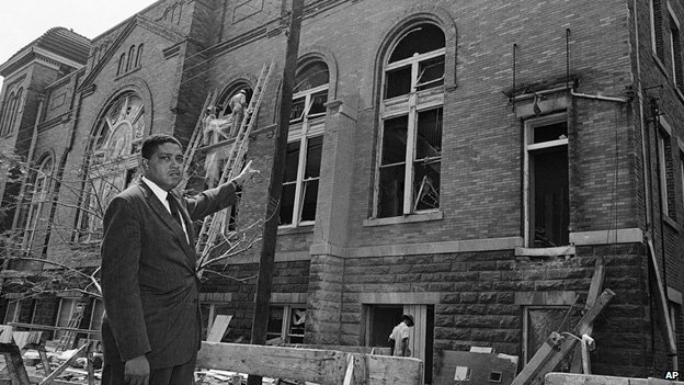 Rev John Cross points to the damage at the 16th Street Baptist Church in Birmingham, Alabama, a few days after the bombing