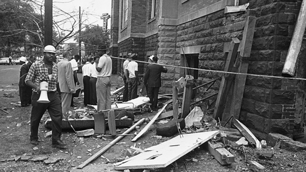 Investigators work outside the church in the aftermath to the bombing