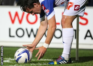 Joey Barton wears rainbow coloured shoe laces as part of a campiagn against homophobia