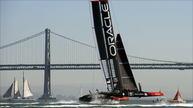 Oracle Team USA crosses the finish line ahead of Emirates Team New Zealand