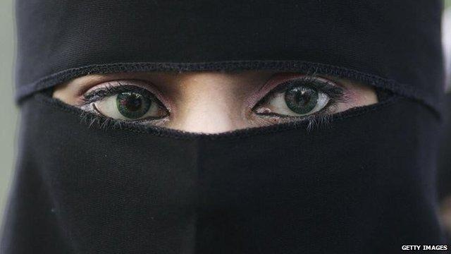 A young Muslim woman wearing a niqab.
