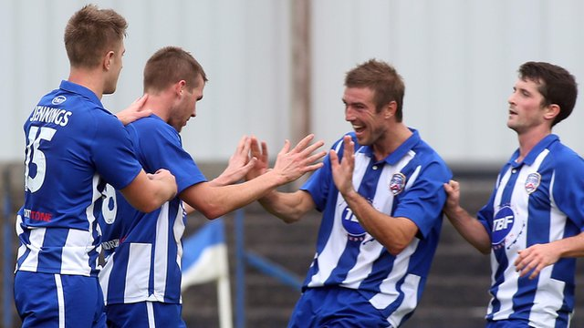 Coleraine players celebrate victory over Warrenpoint at The Showgrounds