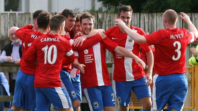 Linfield players celebrate beating Ballinamallard at Ferney Park