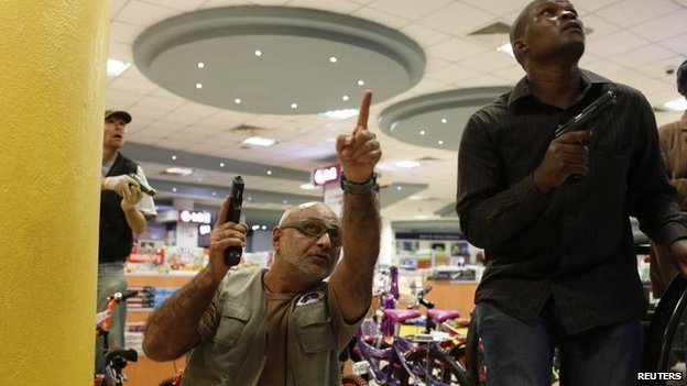 Security forces secure an area inside the Westgate shopping centre, Nairobi (21 September)