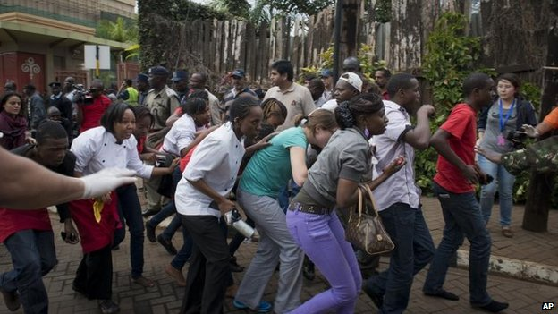 Civilians flee the Westgate shopping centre, Nairobi (21 September)