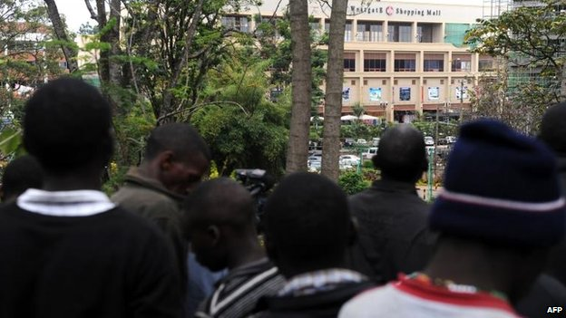 Local residents watch the siege at Nairobi's Westgate Centre (22 September)