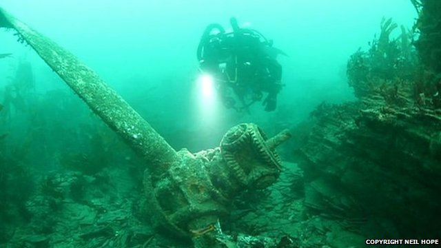 Diver with wreckage of Sunderland plane
