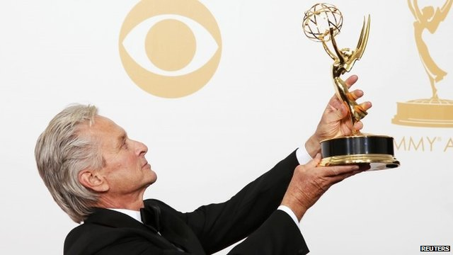 Michael Douglas poses with his 'Outstanding Lead Actor In A Miniseries Or A Movie' Emmy award, which he won for his role as Liberace in the movie 'Behind The Candelabra'