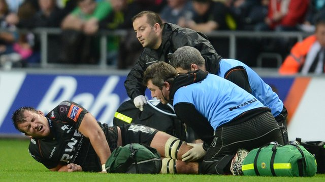 Tom Smith getting treatment for a suspected dislocated knee