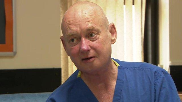 Jim Doyle in hospital scrubs