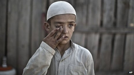 Wali Mohammed, 10, who was displaced with his family from Pakistan's tribal region of Mohmand Agency due to fighting between the Taliban and the army, in Islamabad 20 September 2013