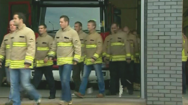 Fire crew walk out
