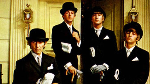 Photo of the Beatles posing as City financiers in 1964