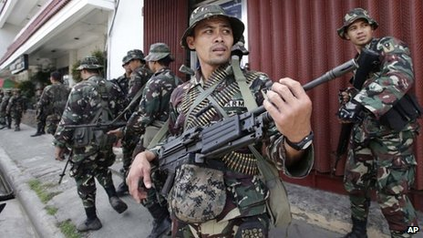 Government troopers patrol to secure the city streets as fighting between government forces and Muslim rebels continues Saturday, 21 September, 2013 in Zamboanga city in southern Philippines