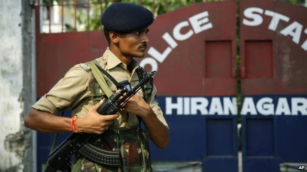 An Indian paramilitary soldier stands guard outside the site of an attack, at a police station in Hiranagar,