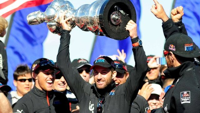 Ben Ainslie lifts the America's Cup trophy