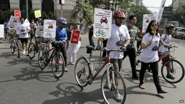 Activists march with bicycles and posters during an awareness rally on environment friendly non-polluting transport in Kolkata, India, Sunday, Sept. 8, 2013. The activists demanded that the authorities withdraw the restrictions on cycles and other non-motorized transport in Kolkata's main streets