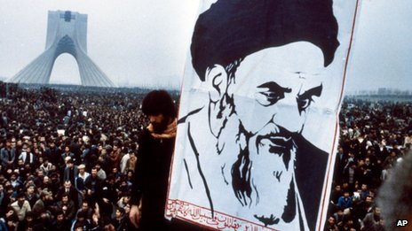 Anti Shah Pahlevi demonstration in Tehran, December 1978, with placard showing Ayatollah Khomeini in the foreground