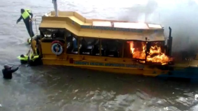 Tourist boat on fire
