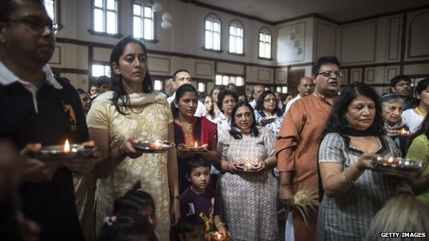 People of the Jain community hold candles during a 24 hour prayer session for the victims of the Westgate Shopping Centre attack on September 29, 2013 in Nairobi, Kenya.
