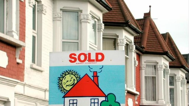 Sold board outside houses
