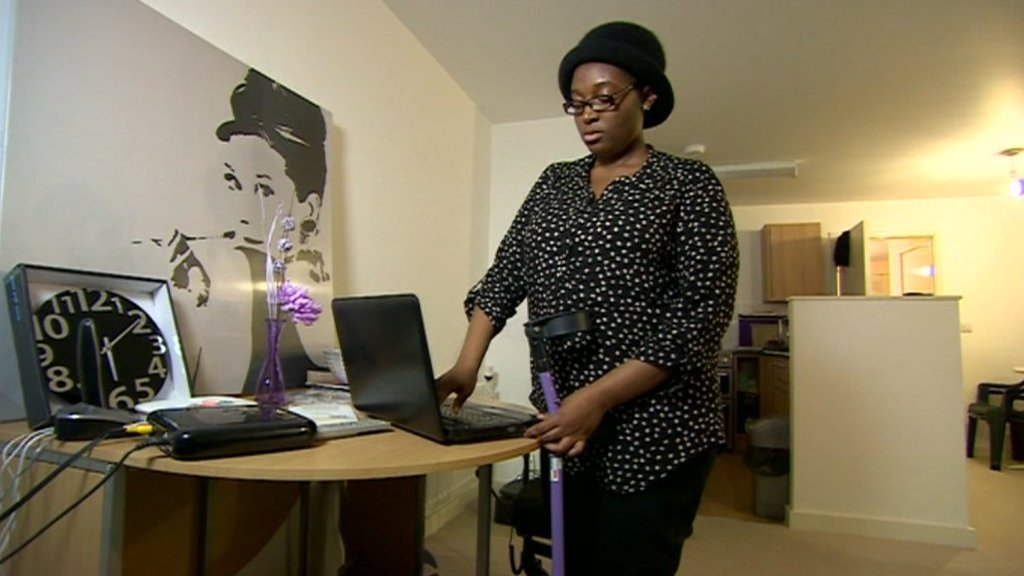 Disabled student opens laptop