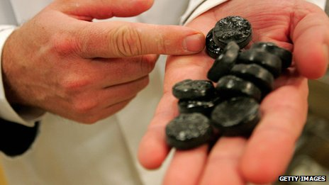 Man shows off liquorice in his Dutch factory