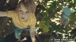 The boy falls out of a tree in the advert