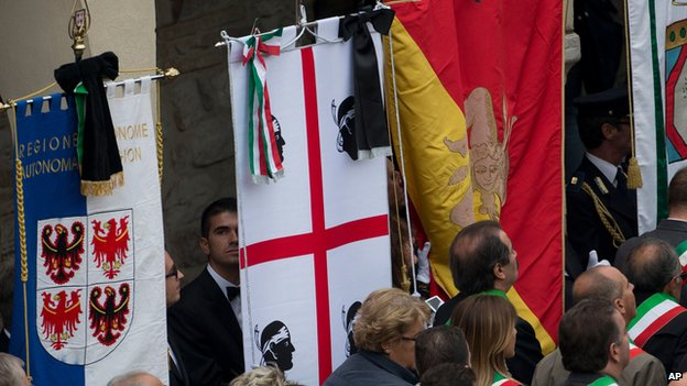 Black ribbons tied to flags in Assisi during Pope's visit on 4 October 2013
