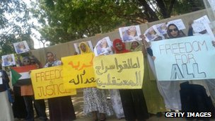 Sudanese women hold placards in a protest calling for the release of prisoners held during protests