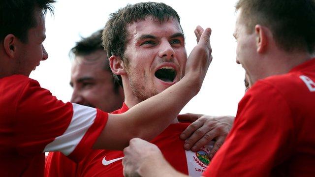 Linfield's Philip Lowry celebrates scoring against Glenavon