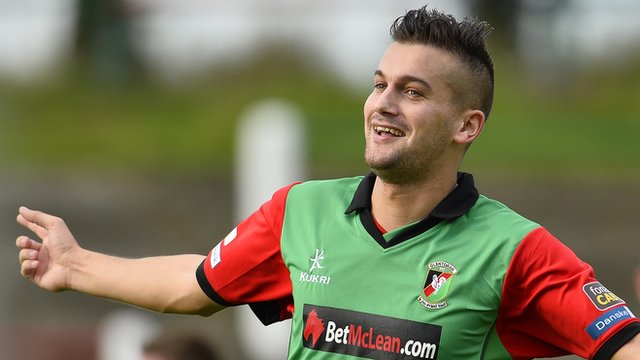 Mark Miskimmin celebrates scoring the winning goal against Dungannon Swifts at The Oval