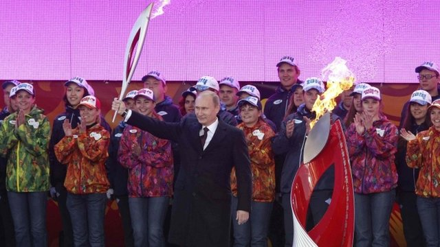 President Putin received the Olympic flame in Red Square and lit the cauldron