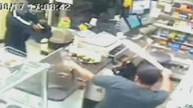 A shopkeeper pulls a machete on an armed robber