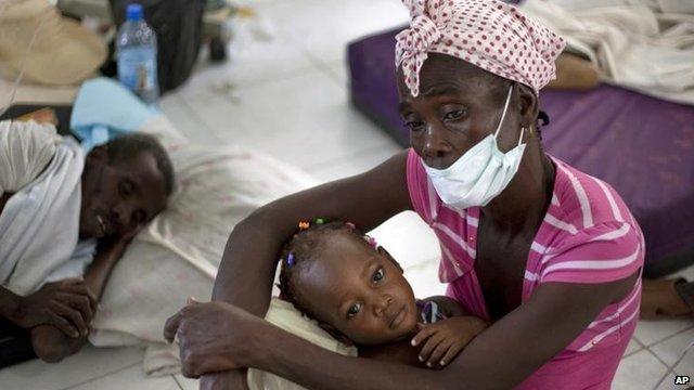 Sick victims receive treatment during cholera crisis in Haiti, October 2010