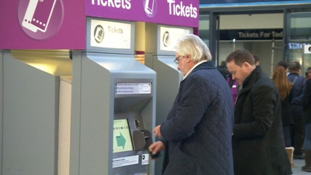 Men at automatic ticket machines